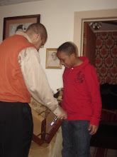 Photo: Jihad looks at the briefcase Kalonji got him