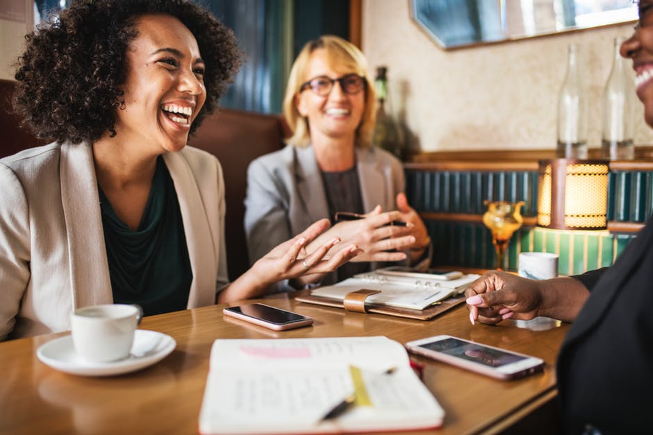 Photo of Women Laughing During Business Meeting.