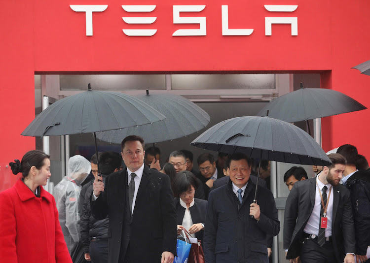 Tesla boss Elon Musk (left) walks with Shanghai Mayor Ying Yong during the ground-breaking ceremony for a Tesla factory in Shanghai.