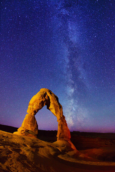 """Photo: ***EXCLUSIVE***  UTAH - OCTOBER 19: A photograph of Delicate Arch, and Milky Way stars at Arches National Park on October 19, 2011 in Utah.  Stunningly beautiful images capture the glory of the Milky Way taken with just a simple digital camera. Revealing the Earth's place in our swirling galaxy, the pictures on display look like they could have been snapped with a million pound telescope not a readily available camera. And incredibly, photographer Royce Bair has only been turning his lens to the night's sky for the past six months. Calling his series """"Night Scapes', Royce, (insert age) created the erie and ghostly images by visiting some of America's most famous national parks.  PHOTOGRAPH BY Royce Bair / Barcroft USA  UK Office, London. T +44 845 370 2233 W www.barcroftmedia.com  USA Office, New York City. T +1 212 796 2458 W www.barcroftusa.com  Indian Office, Delhi. T +91 11 4053 2429 W www.barcroftindia.com"""