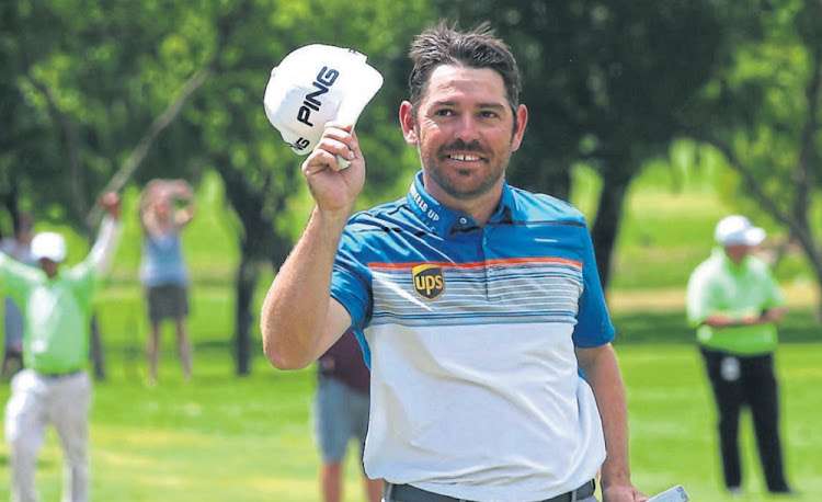 All smiles: Louis Oosthuizen celebrates his victory at the SA Open on Sunday. Picture: SHAUN ROY/SUNSHINE TOUR/GALLO IMAGES