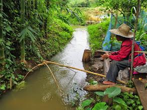 Photo: Muang Kong village fishing for her dinner