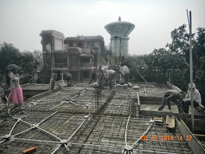 Photo: Ground Floor roof casting .. at the end you can see the concrete being poured...
