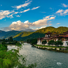 Beautiful Punakha dzong by Arindam Patra - Buildings & Architecture Other Exteriors ( blue sky, greenery, sunshine, fort, river, clouds )
