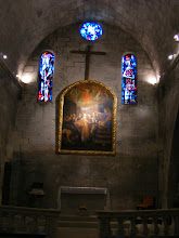 Photo: The simple interior of the 12th century Église St-Vincent, with contemporary stained glass by Max Ingrand.