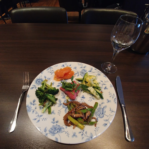 Variety of starters: smoked salmon, asparagus and mushroom salad, broccoli salad, pineapple and cucumber salad, beef