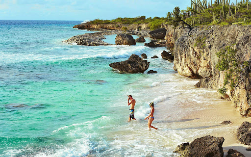 bonaire-cove-snorkelers.jpg - Snorkelers head into a secluded cove in Bonaire.