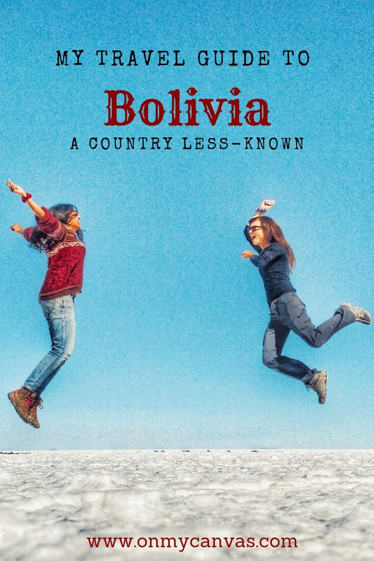 an indian girl and a canadian woman jumping in uyuni salt flats salar de uyuni bolivia while traveling in south america photos being used for pinterest image for bolivia travel and backpacking guide