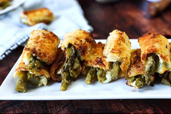 Asparagus Roll Appetizers Baked To Golden Brown.