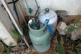 Photo: Gaz containers connected in an unsafe way at the She HaGdolim housing estate, families cannot afford the central gaz which has been disconnected in many cases. Instead they make their own, very dangerous, connections.