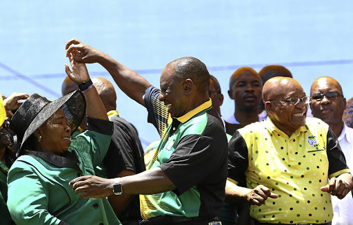 Nkosazana Dlamini-Zuma dances with ANC president Cyril Ramaphosa alongside President Jacob Zuma at the ANC's birthday bash in East London.