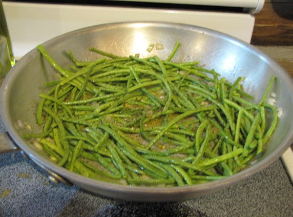 Add the green beans to the pan, sprinkle some balsamic vinegar or Garlic Red...