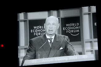 Photo: DAVOS,23JAN03 - Klaus Schwab seen on a monitor of a TV-camera while speaking during the session 'Update on Values 'at the 'Annual Meeting 2003' of the World Economic Forum in Davos/Switzerland, January 21, 2003. 