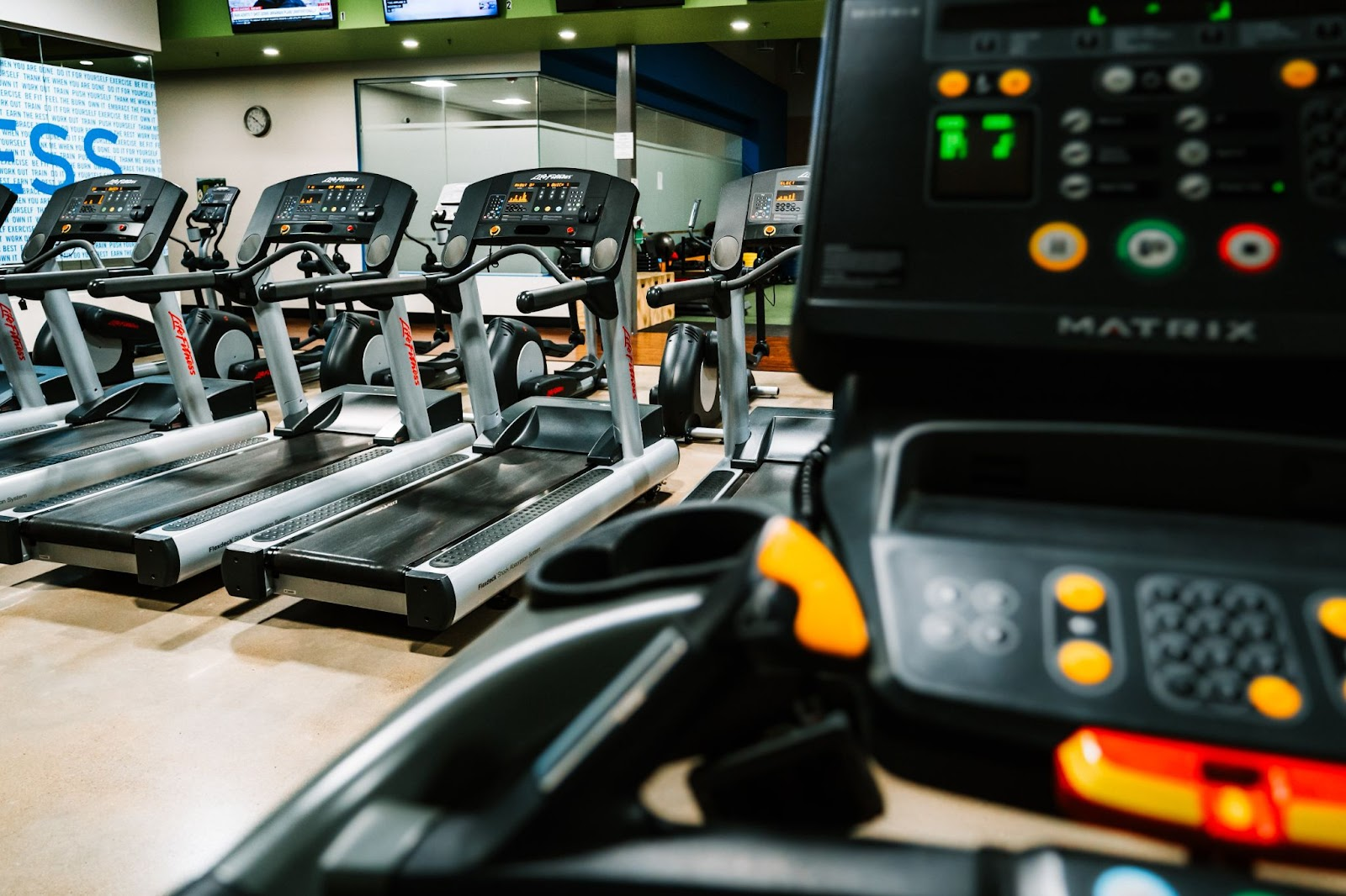 A picture of a row of treadmills, if you're looking for a treadmill for your home you should consider these tips
