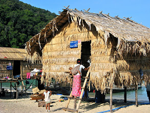 Photo: sea gypsy family entering their home