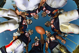 Photo: Football Team in a Huddle --- Image by © Royalty-Free/Corbis