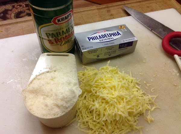 Add cheeses (stir frequently to keep from sticking).  Keep the heat on medium...