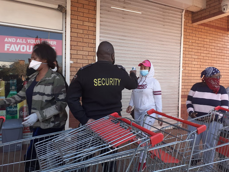 A women getting her temperature taken outside the Makro in Springfield, Durban, before the store opened at 9am.