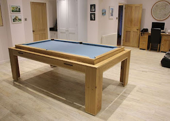 Elevated Pool Table With Light Blue Felt in dining room