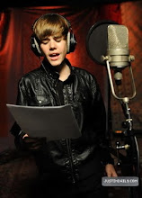 """Photo: HOLLYWOOD - FEBRUARY 01:  Singer Justin Bieber performs at the """"We Are The World 25 Years for Haiti"""" recording session held at Jim Henson Studios on February 1, 2010 in Hollywood, California.  (Photo by Kevin Mazur/WireImage)"""