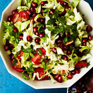 Shredded Cabbage Salad with Pomegranate and Tomatoes.