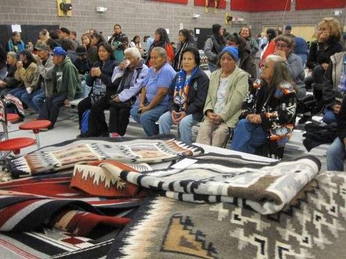 Weavers waiting for auction to begin. - Photo by Anne Galer