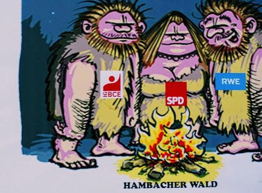 Demo-Transparent, Karikatur: Drei Steinzeitmenschen (IG BCE, SPD, RWE) verbrennen das letzte Holz vom Hambacher Wald.