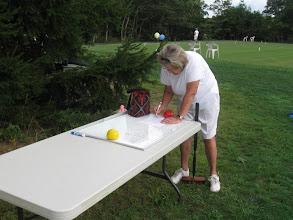 Photo: Nance Stewart checks the play schedule.