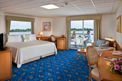 Queen-of-the-Mississippi-stateroom.jpg - Couples can enjoy the perfect honeymoon in one of the spacious staterooms on an American Cruise Lines ship, which feature contemporary furniture and a private balcony.