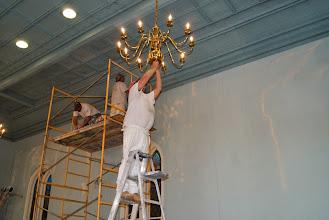 Photo: Fixing the light bulb!
