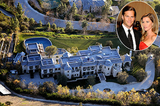 Photo: Tom Brady and Gisele Bundchen have added a private play area for their two children at their $20 million eco-friendly mansion in Brentwood, California. The swings and slide can now be seen on a grassy hill with a new walled garden area leading up to the private play area for their three year old son, Benjamin Rein Brady, and newborn daughter, Vivian Lake Brady. This is yet another addition to the  22,000 square foot compound which features a six-car garage, a lagoon-shaped swimming pool with spa, a mini waterfall, a bridge over a small moat which acts as their front entrance, children's play area, basketball court,  a weight room forn Tom to train in, a wine cellar and numerous  solar energy panels on the roof and one on the side of the hill next to the house. The mansion has been 3 years in the making after the couple purchased a vacant lot of land on the high-end retail area of Madaville Canyon for $11 million. Neighbours include Heidi Klum, and Arnold Schwarzenegger.<P>Pictured: Tom Brady, Gisele Bundchen, Brentwood home, Los Angeles, California