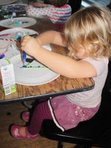Toddler doing an art project at a table