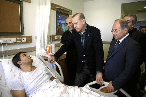 Deadly bombings: Turkish President Recep Tayyip Erdogan visits a police officer, who was injured in Saturday's blasts, in a hospital in Istanbul, Turkey, on Sunday. Picture: REUTERS
