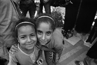 Photo: Two girls smiling for the camera...