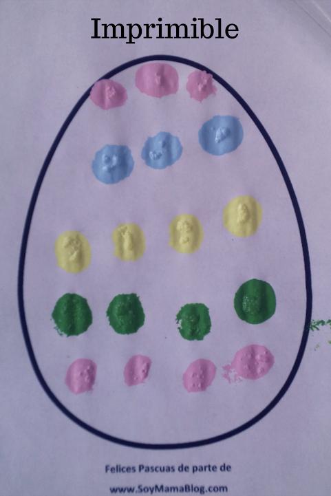 Huevo de Pascua decorado con pompones y pintura