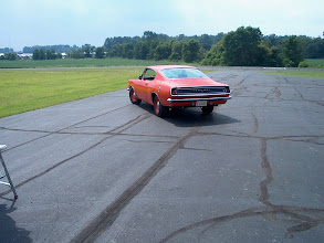 Photo: Mopar Collectors Guide and Mopar Muscle chose the air port near the show field for a photo shoot. fresh black top and green grass are a nice setting