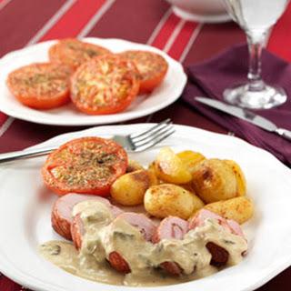 Gevulde Varkenshaas Met Champignonsaus En Geroosterde Tomaten