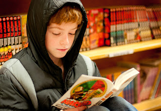 Photo: Book Worm - Powell's Book Store Portland, OR  I love that my kids love to read. Today was cold and wet here in Portland so I grabbed my new nifty fifty 1.4 and headed downtown with the kids to our favorite shop. While my daughter perused the Rose Room my son plopped down with some Manga to read. Me? Well I grabbed some shots.  #lastcall