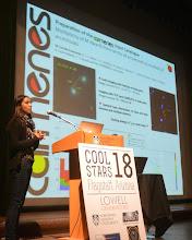 """Photo: Miriam Cortés-Contreras during the Poster Pop-up of the CARMENES posters at """"Cool Star 18"""" #cs18 - In the Splinter session. """"Portraying The Hosts: Stellar Science From Planet Searches""""."""