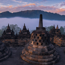 Sunrise at the Temple by Keith Walmsley - Buildings & Architecture Public & Historical ( hill, sunrise, nature, temple, clouds, worship, indonesia, landscape )