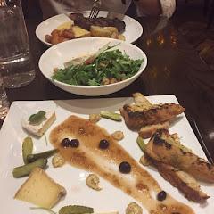 Cheese plate, brie salad, and a ribeye steak