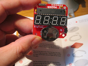 Photo: Not bad for two caps, one resistor, one crystal, a button, an ATMega328, a 4-digit 7-Segment display and a battery.