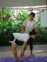 Photo: Jeenal teaching Asana correction to Bao - Trikonanasa