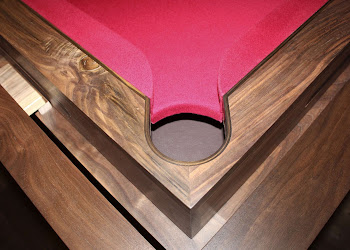 Side pocket top view of pool table with red felt