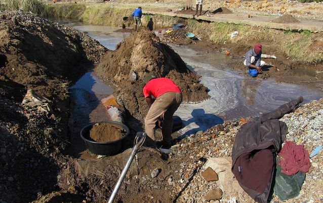 Illegal miners work on a disused mine in Welkom, Free State.  Picture: SOWETAN