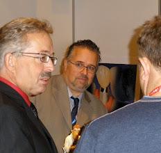 Photo: Ulrich Heker & Klaus Viesteg talking to visitor