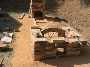 Photo: Bamboo sticks hold up arch in bourry-style firebox.