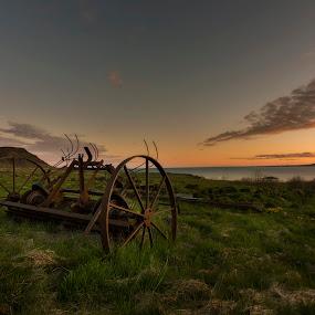 The wheel by Kaspars Dzenis - Uncategorized All Uncategorized ( farm, field, iceland, sunset, landscape, fjord )