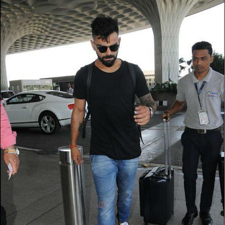 virat kohli at airport with bentley continental