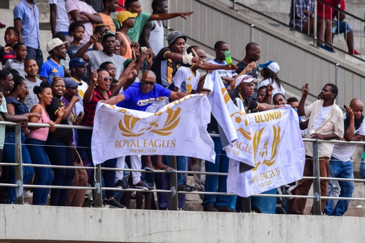 DURBAN, SOUTH AFRICA - FEBRUARY 09: Royal Eagles fans with flags during the National First Division match between Royal Eagles and University of Pretoria at Chatworth Stadium on February 09, 2019 in Durban, South Africa.